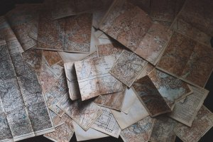 Physical maps scattered on top of each other.