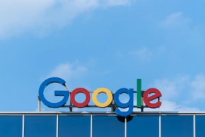 Google sign against blue sky.